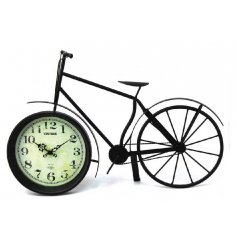 Large black clock inside a decorative bike ornament