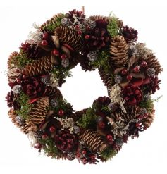 A full and natural wreath made from traditional pinecones and berries.