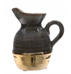 A glamorous black and gold metallic vase with handle.