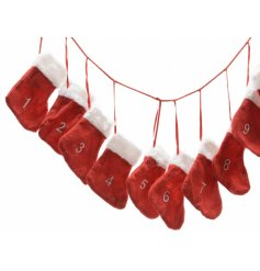 A cute and fun advent garland made from numbered stockings, each with a fur trim.