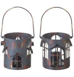 A mix of 2 unique house design lanterns, creating a lovely warm glow this season.