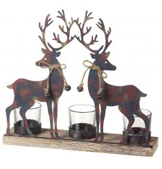 A stunning t-light holder with rustic metal reindeer figures set upon a wooden base with 3 t-light holders.
