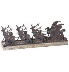 A charming rustic metal t-light holder with Santa and his sleigh.
