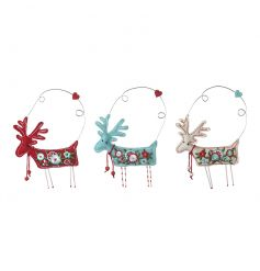 Cream, red and blue fabric reindeer decorations each with a beautiful embroidered design.