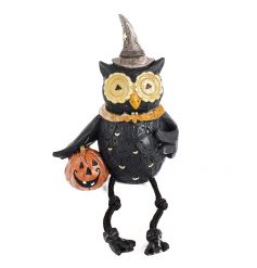 A stylish black owl shelf sitter with pumpkin features at witches hat.