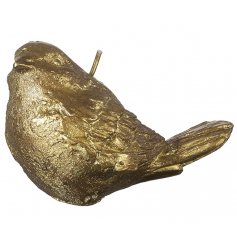 Beautifully delicate sparrow shaped wax candle with a glittery gold coating