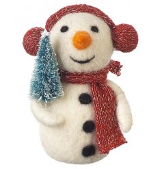 A wool snowman ornament with glitter scarf, ear muffs and mini tree decoration.