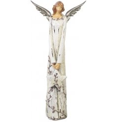 A classic and elegant angel decoration in cream with a touch of festive sparkle.