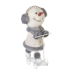 Create a feature with this unique and charming snowman with scooter decoration.