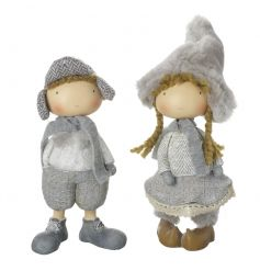 A mix of 2 charming boy and girl standing figures in winter clothes.