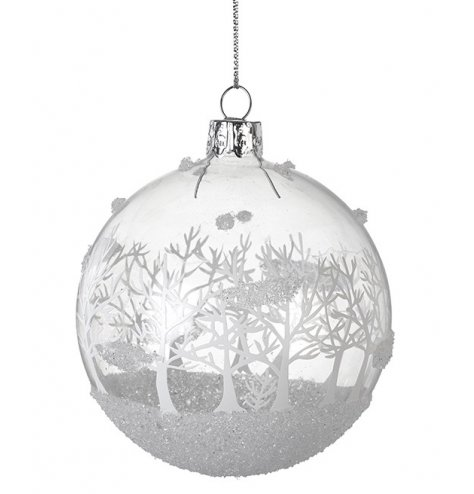 A stunning glass bauble decorated with a white and silver glitter forrest scene. Complete with silver string hanger.
