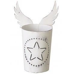 A pretty metal t-light holder with a star cut out design and angel wings.