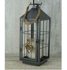 A chic and stylish metal lantern with a heart plaque with reindeer design.
