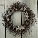 A stunning natural birch wreath with star and pinecone decorations and a touch of glitter to finish!