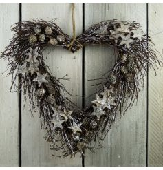 A natural birch heart wreath with glitter stars and pinecones.