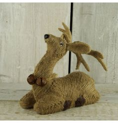 A charming woodland style sitting reindeer with jute finish and rustic bells.