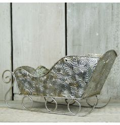 A stunning silver sleigh decoration with a distressed finish. Perfect for displaying baubles, fruits and chocolates!