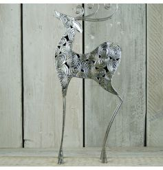 A stunning large silver reindeer ornament with a swirl design and distressed finish.