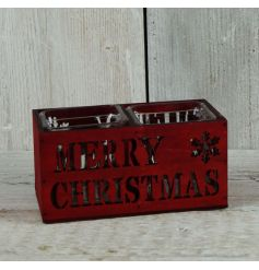 A rustic wooden candle holder for two candles. Features a Merry Christmas slogan and snowflake design.