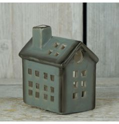 A festive style ceramic candle holder. A unique festive decoration which glows beautifully with t-light inside.