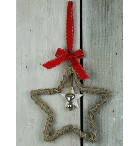 A hanging wooden star with wicker wrapped around, hanging metal hearts in the centre and festive red ribbon for hanging.