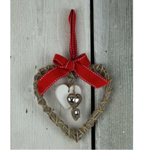 A hanging wooden heart with wicker wrapped around, hanging metal hearts in the centre and festive red ribbon for hanging