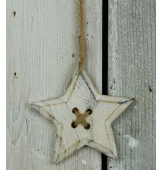 A white washed wooden star decoration with jute hanger.