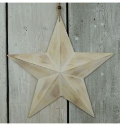A 3D wooden barn star with a white washed finish. A great accessory for walls and doors