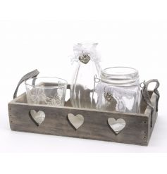 Rustic wooden tray with an assortment of glass bottles