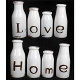 Love and Home bottles in a set of four