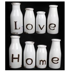 Set of four bottles with Love and Home text