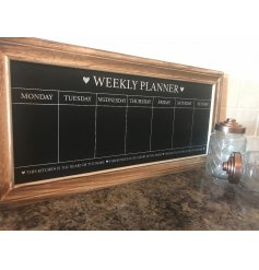 A shabby chic wooden chalkboard with weekly planner design