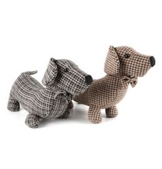 A mix of 2 adorable tweed sausage dog doorstops, each with a decorative bow tie.