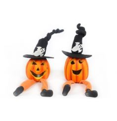 A mix of 2 pumpkin decorations with spooky hats and LED light.