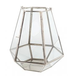A hexagonal glass lantern with a classic silver frame