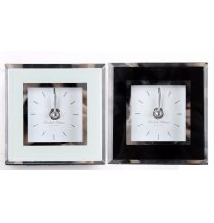 2 assorted small glass clocks