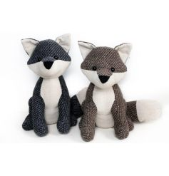 A mix of 2 country style fox doorstops in black and brown hues.