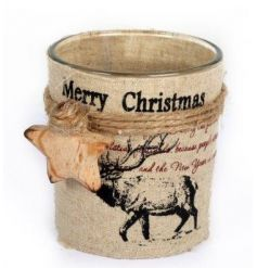 A rustic t-light holder with a vintage Christmas print and natural wooden star detail.