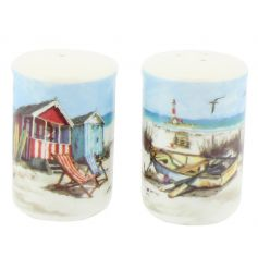 A charming set of salt and pepper shakers, each with a vintage style coastal scene.
