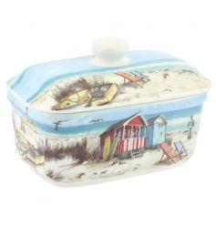 A charming butter dish with a sandy bay design.