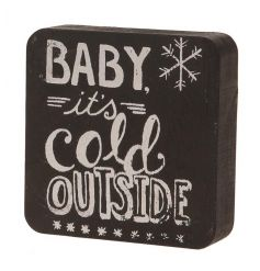 A shabby chic 3D block sign with a printed Baby It's Cold Outside slogan.
