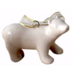 A small ceramic polar bear decoration with gold organza ribbon to hang.