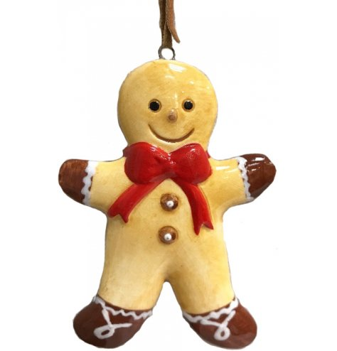 A traditional gingerbread man decoration with a large red bow and smiling face. Complete with a PU leather brown hanger.