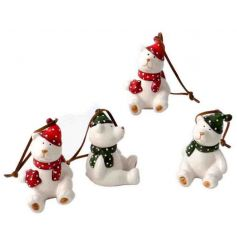 An assortment of adorable bear decorations each with a festive polka dot scarf and hat.