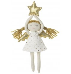 sweet little girl holding a star hanging ornament