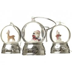 An assortment of 3 hanging snow globe decorations with santa, snowman and reindeer designs.