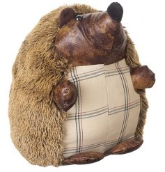 Sweet little woodland hedgehog doorstop with a faux leather face and patterned tummy