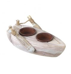 A coastal whitewashed wooden boat decoration with two t-light holders.