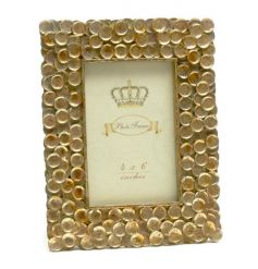 Add some decadence to the home with this gorgeous gold disc photo frame with an antique finish.