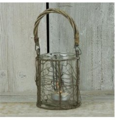 A rustic style wire lantern with willow handle.